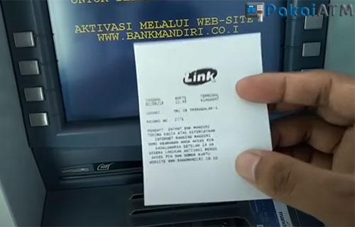 Beberapa saat kemdian struk registrasi akan keluar dari mesin ATM